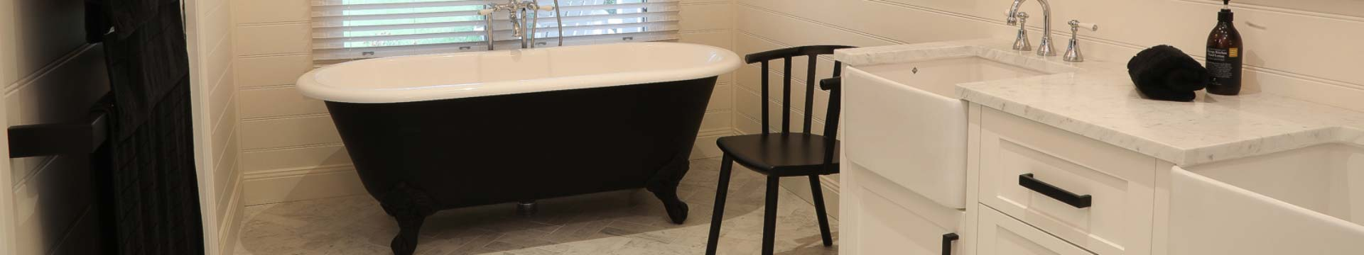 Black and white bathroom with marble floor